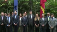 Mourners and political figures join Spain's ambassador to Venezuela at the Spanish Embassy in Caracas for a minute's silence for the 14 people killed...