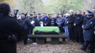Mourners attend the funeral of four year old murdered Bosnian refugee boy named Mohamed in the Muslim part of the cemetery in Berlins Gatow district