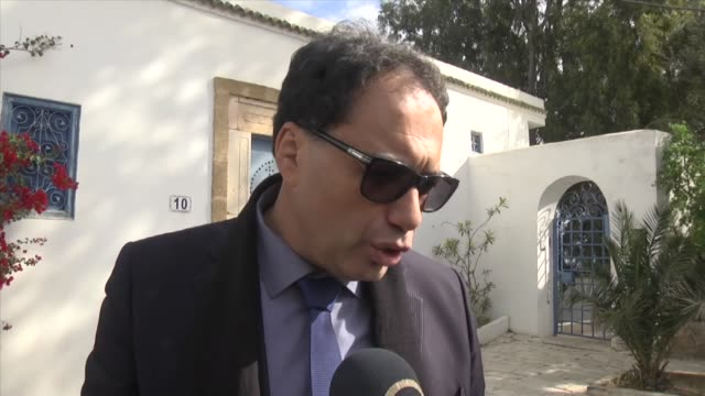 Mourners attend the funeral of the late Tunisian fashion designer Azzedine Alaia who died this month aged 77 in the Sidi Bou Said cemetery in the...