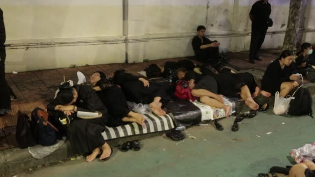 Mourners camp out in the early morning ahead of the cremation of the late King Bhumibol Adulyadej in Bangkok Thailand on Thursday Oct 26 Photographer...