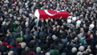 Mourners carrying the coffin of one of the victims of the Reina night club shooting in Istanbul