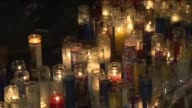 Mourners gathered outside the childhood home of NYPD Officer Rafael Ramos Sunday evening for a candlelight vigil to honor the fallen cop and his...