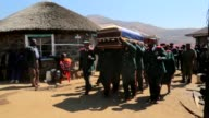 Mourners including King Letsie III gather for the funeral of Lesotho's army commander Khoantle Motsomotso was gunned down by rival officers as the...