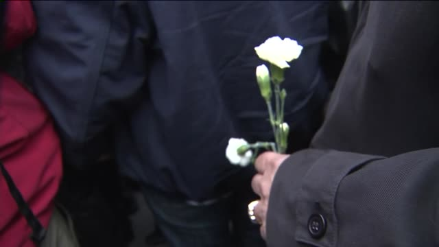 Mourners lit candles and laid flowers at the memorial site for slain NYPD Officer Rafael Ramos and Officer Wenjian Liu on December 22 2014 in New...