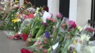 Mourners place candles and flowers at the Belgian embassy in Copenhagen in tribute to the 31 people killed and 270 injured in blasts at Brussels...