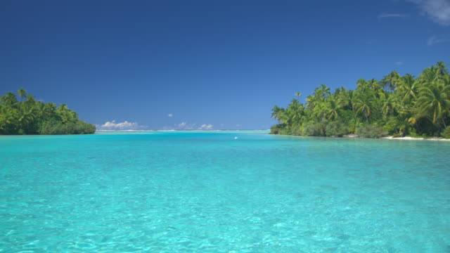 POV, Moving across tropical water between island, Aitutaki Lagoon, Aitutaki, Cook Islands