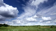 Moving clouds and meadow Timelapse