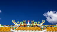 Moving clouds at the roof of Chinese shrine temple