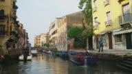 POV, Moving on narrow canal at dawn, Venice, Italy