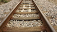 Moving on train tracks at walking speed, camera on stabilizer