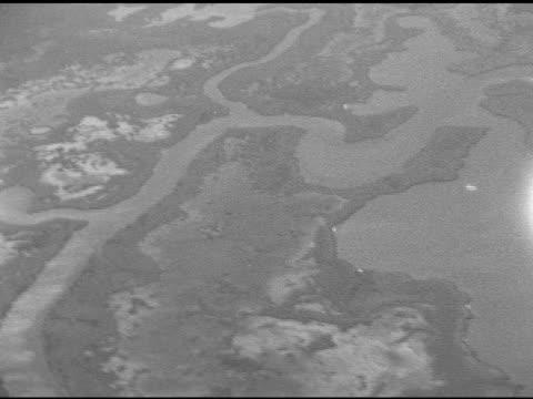 Moving over unidentified waterways near Gulf of Mexico possibly Intracoastal Waterway tributaries Louisiana wetlands coastal marsh marshland Note...