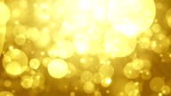 Moving Particles Loop - Abstract gold bokeh hd background