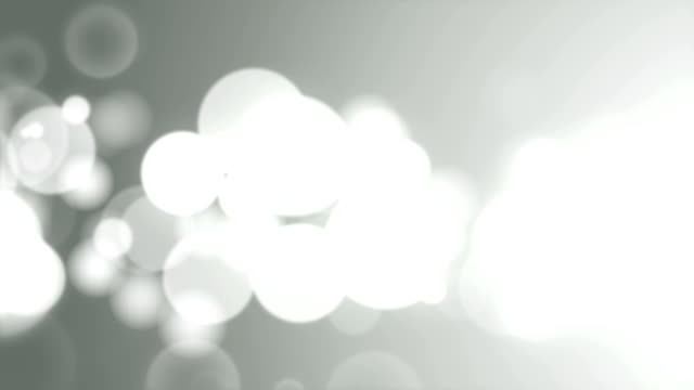 Moving Particles Loop - Abstract Grey Defocused Lights Background