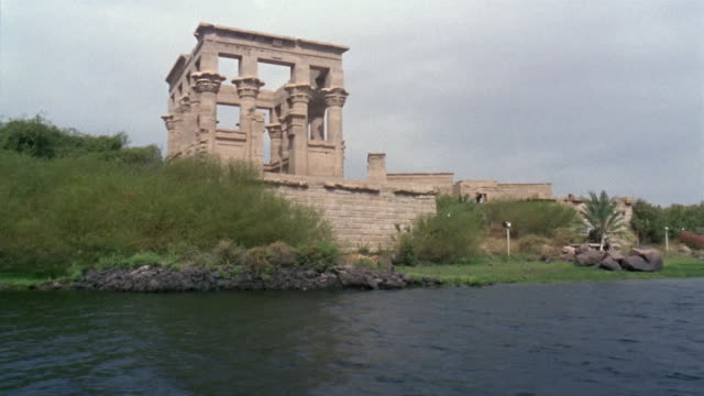 WS BOAT POV Moving past Hypostyle Hall at the Temple of Philae/ Egypt