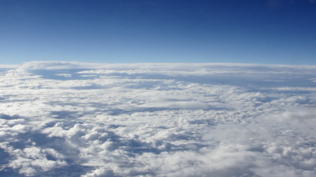 AERIAL Moving shot of white clouds nestled in blue sky