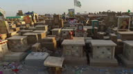 Moving shot past graves in Wadi AlSalaam cemetery the largest in the world in Najaf Iraq