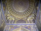 A moving view, starting from the ceiling and moving down the wall of a mosque in Samarkand