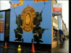 Mowlam seeks end to punishment attacks LIB GV 'UVF' Mural showing masked gunmen on wall LS 'IRA' Sign in large letters on post at side of road LIB...