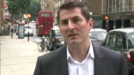 MPs call for cap on private hire vehicles Reporter to camera Cars queuing David Leam interview SOT Private hire cars queuing with yellow stickers on...