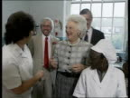 Mrs Bush Brixton visit ENGLAND London Brixton High St Elm Pk Strand Adult Education Centre Barbara Bush in grey skirt grey check shirt pearls RL...