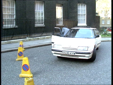 Mrs Thatcher anniversary EXT Gv's of flowers arriving at No 10 / Gv's of guests arriving for dinner at No 10 / Kenneth Baker / Sir Geoffrey Howe /...