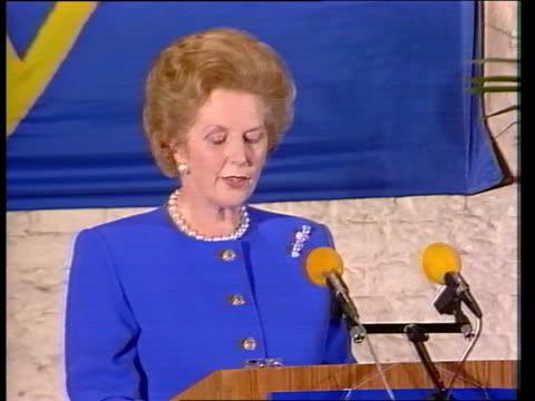 Mrs Thatcher EEC speech in Belgium BELGIUM Bruges Airport Margaret Thatcher down aircraft steps as followed by officials MS Thatcher talking to...