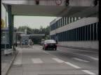 Mrs Thatcher EEC speech in Belgium ITN LIB Aachen AV 'Aachen Zollamt AutobahnSud' sign on building across road at border TILT DOWN as car along road...