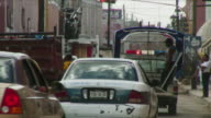 Ms Flashing lights on truck and congested street / Valladolid, Mexico