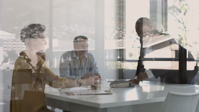 MS_Three businesspeople making conference call in modern office space