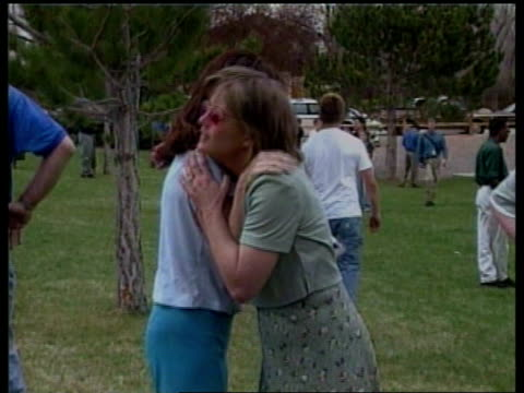 MSs Mothers embracing children at scene of high school shooting BSP120500041