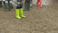 BROLL Mud at Glastonbury Festival Friday at Glastonbury Festival Site on June 27 2014 in Glastonbury England