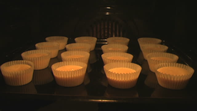 Muffins growing in the oven