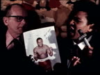 Muhammad Ali and Joe Frazier cause a ruckus at a press event leading up to the The Fight of the Century Muhammad Ali Holds Up Joe Frazier Flyer on...