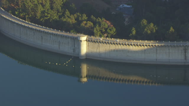 WS AERIAL POV Mulholland Dam and Hollywood Reservoir at Hollywood Hills, California