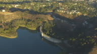 WS ZI AERIAL POV Mulholland Dam and Hollywood Reservoir at Hollywood Hills, California