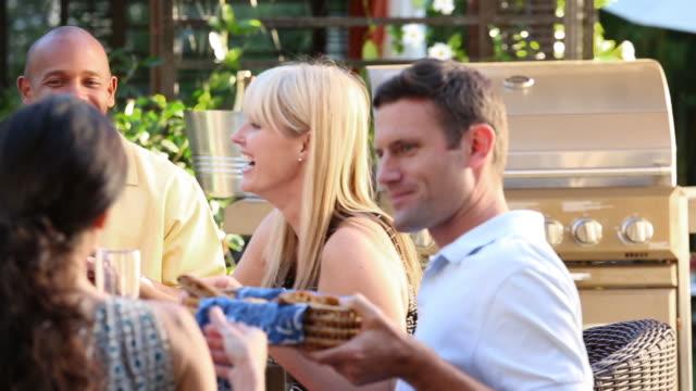MS Multi ethnic friends at backyard barbecue.