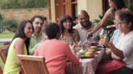 MS Multi Ethnic Group of Adults Eating Together Outside / Richmond, Virginia, USA