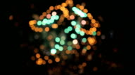Multicolored defocused bokeh lights of exploding fireworks