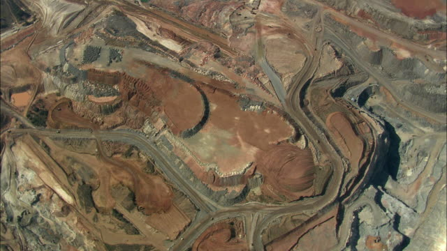AERIAL WS Multi-colored mine workings, piles of ore or dirt, Rustenburg, North West, South Africa