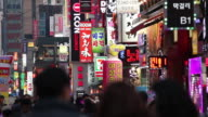 MS Multicolored neon signs on crowded street at night / Seoul, South Korea