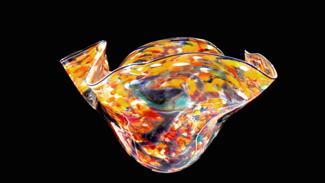MS Multicolored piece of art glass rotating against black background