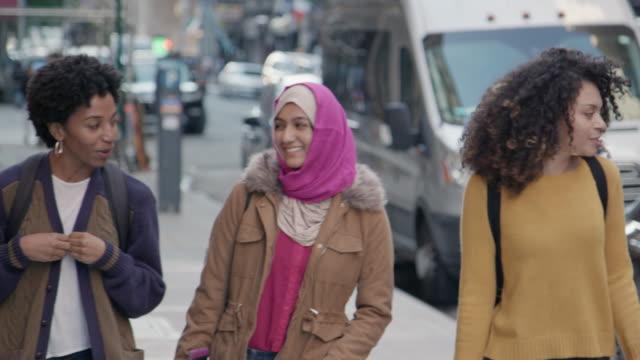 Multi-Cultural Female Friends Walk in the City