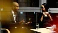 Multi-ethnic business people discussing in board room at night