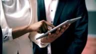 CU Multi-ethnic businesspeople using a digital tablet