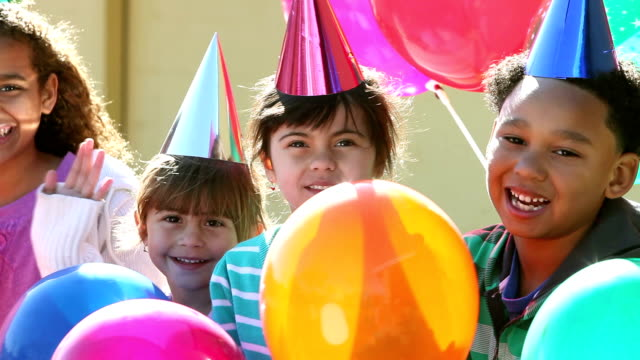 Multi-ethnic children at birthday party