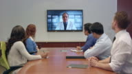 Multi-Ethnic Doctors and Professionals Have Video Conferencing