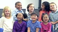 Multi-ethnic group of happy elementary school children