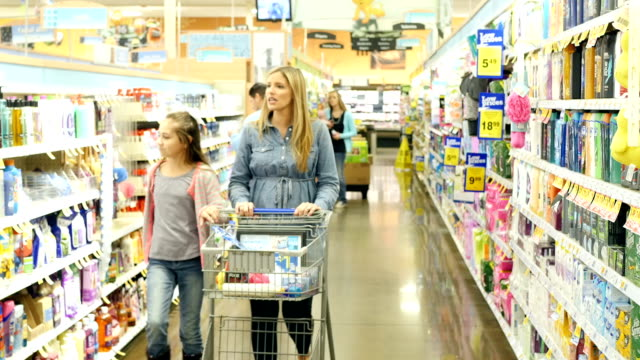 Multi-ethnic group of people shopping in personal care section of supermarket