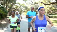 Multi-ethnic group of seniors running in a race