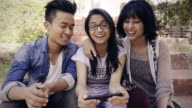Multiethnic happy, college friends together sharing smart phone.